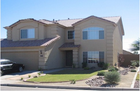 AZ Front yard landscape with grass and riverbed