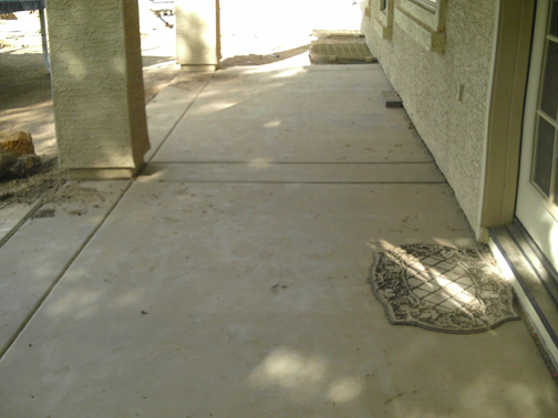 old concrete before new paver patio remodel