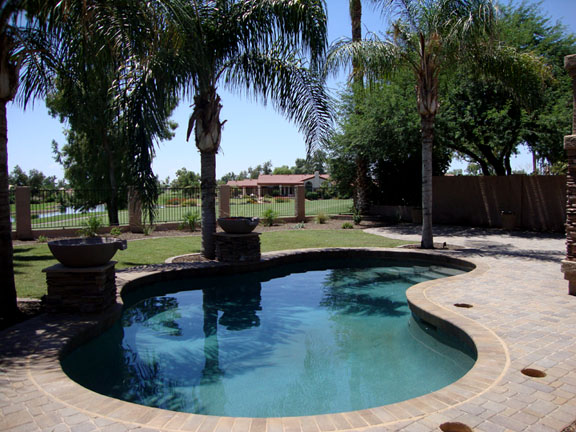 pavers around pool in place of kool decking