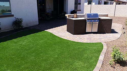 Built In BBQ Bar Pavers Synthetic Grass. Small Backyard Desert Landscape