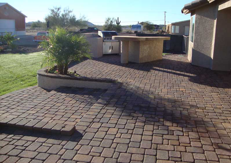 Paver Steps From Raised Patio With Planters In Queen Creek, AZ.