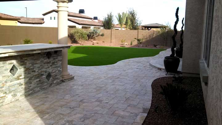 Synthetic Grass With Travertine Pavers